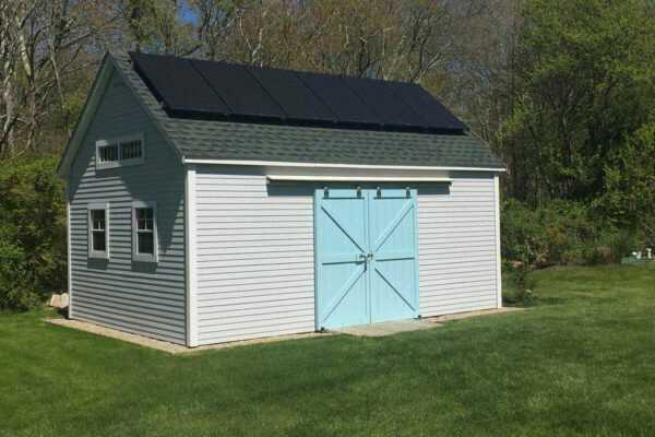 14X20 Cohasset with vinyl siding. This clever customer added solar panels!